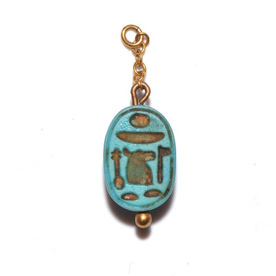 * A rare Egyptian Royal Glass Scarab for Ahmose I, beginning of 18th Dynasty, c. 1539-1514 BC