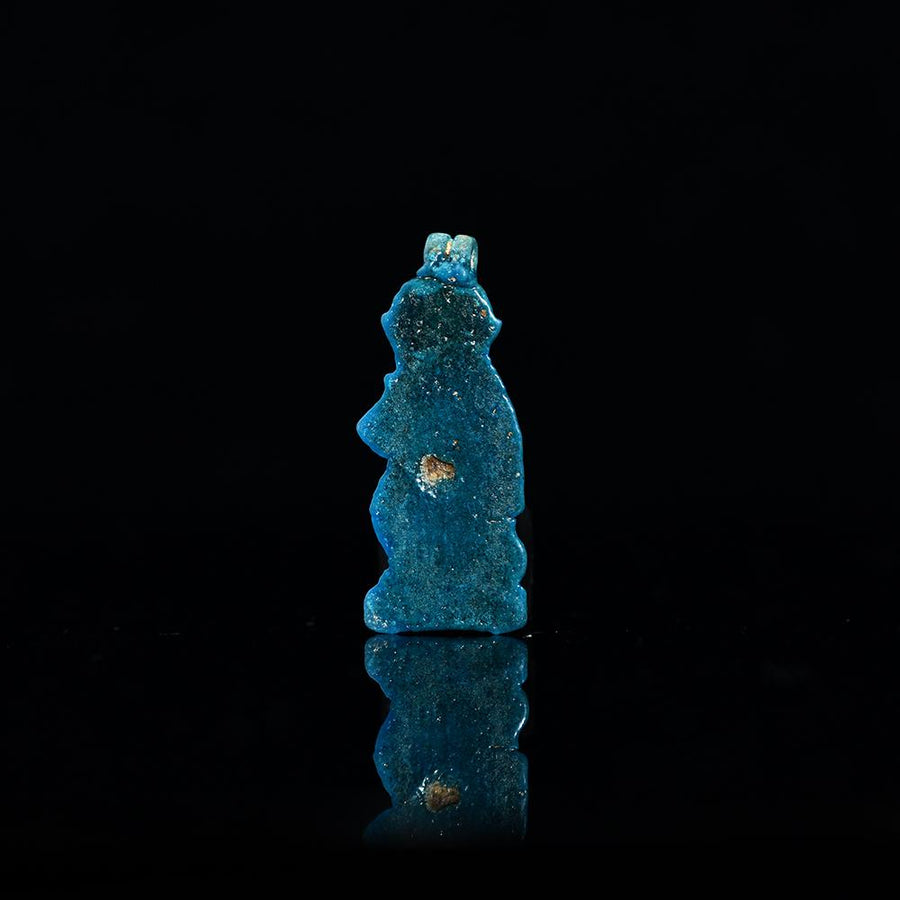 * An Egyptian Faience Baboon Amulet, Third Intermediate Period, 21st Dynasty, ca. 900 - 700 BCE