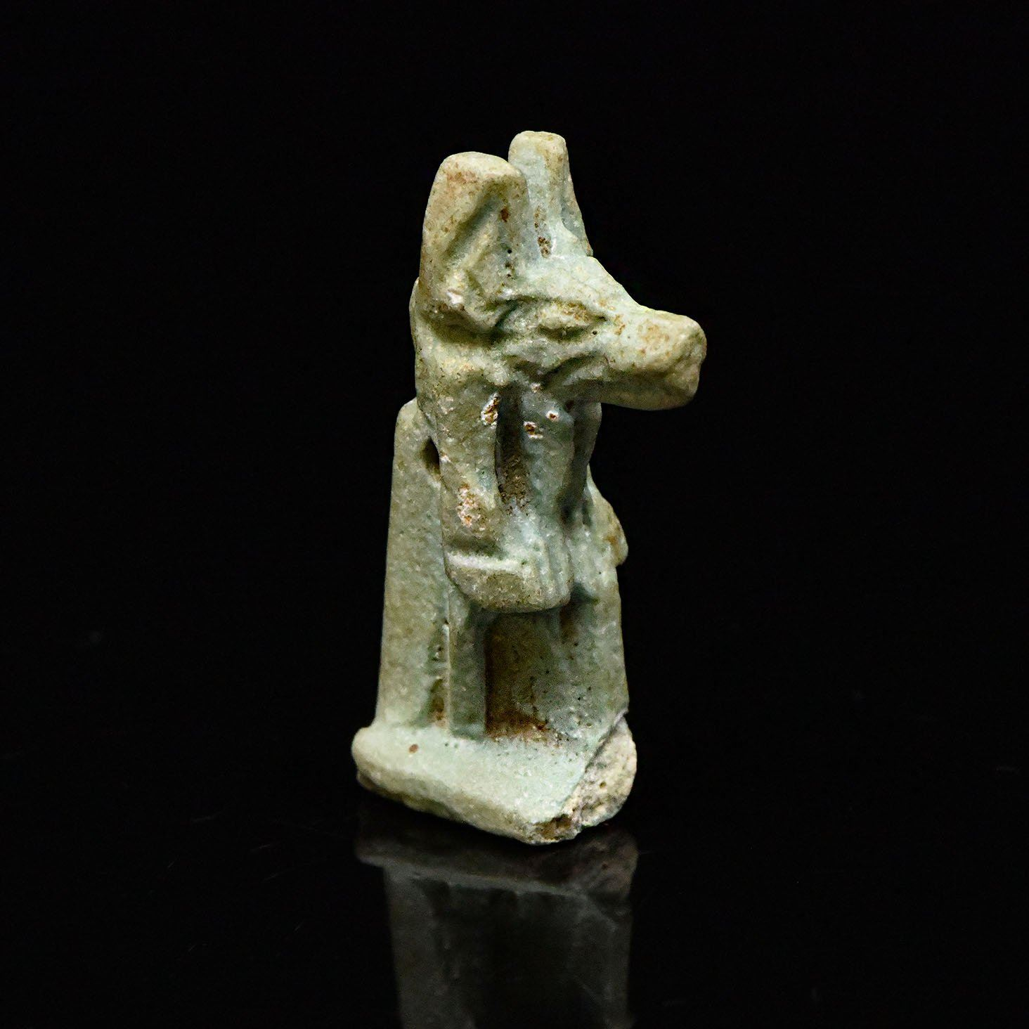 * An Egyptian Faience Amulet of Anubis, Late Period, ca. 664 - 332 BCE