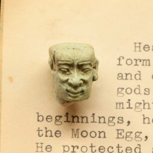 An Egyptian Faience Amulet Head of the God Ptah-Sokar, 12th Dynasty, ca. 1900 BCE - Sands of Time Ancient Art