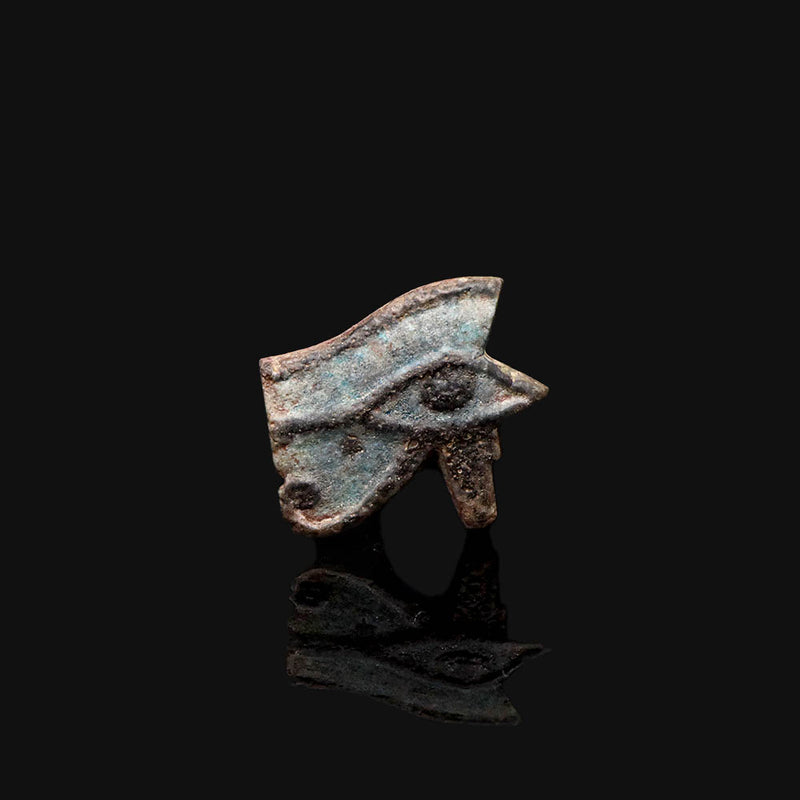 An Egyptian Faience Wedjet Eye Amulet,  Late Period, ca. 664 - 332 BCE