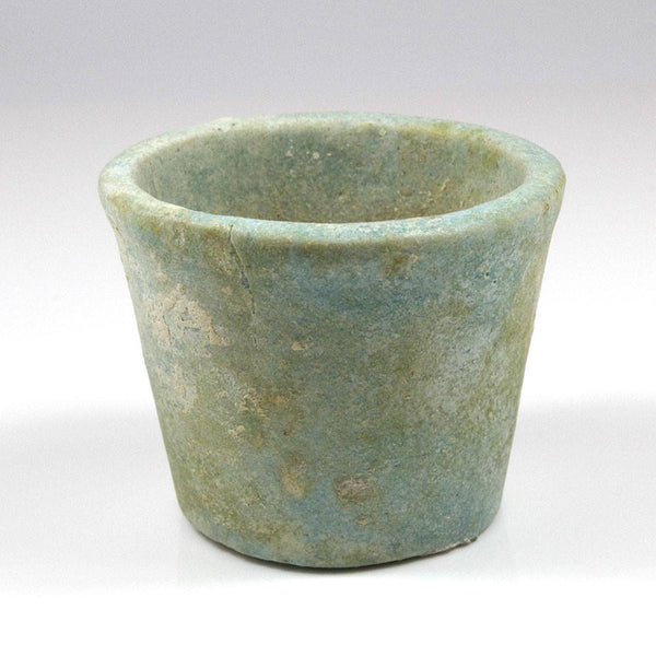 An Egyptian Faience cup with Contents, Dynasty 26, 664-525 BC