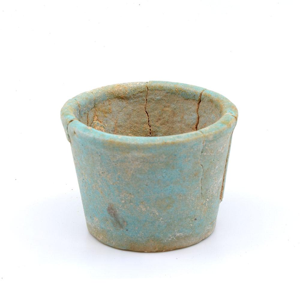 An Egyptian faience offering cup with contents, 26th Dynasty, ca. 664 - 525 BCE
