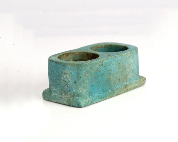 An Egyptian faience votive scribe ink well, New Kingdom, Dynasty XVIII-XX, 1550-1070 B.C.