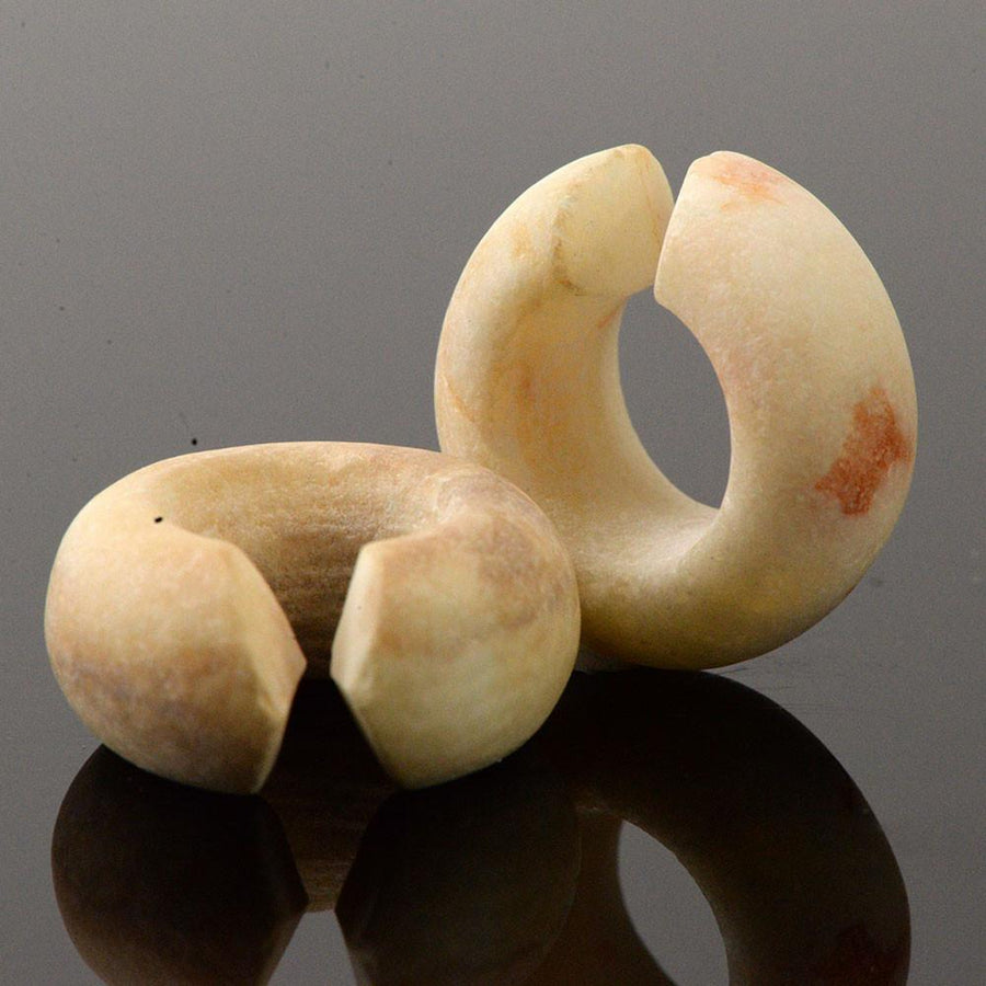 A pair of Egyptian Alabaster Hair Rings, New Kingdom, ca. 1550-1295 BC