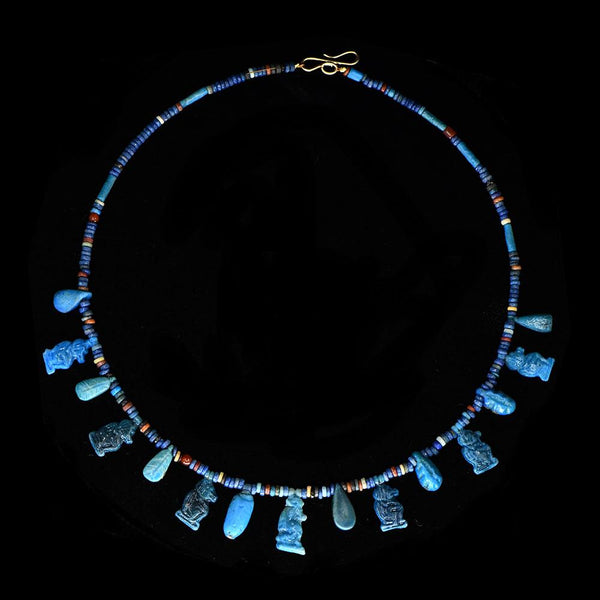 An Egyptian Faience Bead and Amulet Necklace, 18th Dynasty, ca. 1550 - 1295 BCE