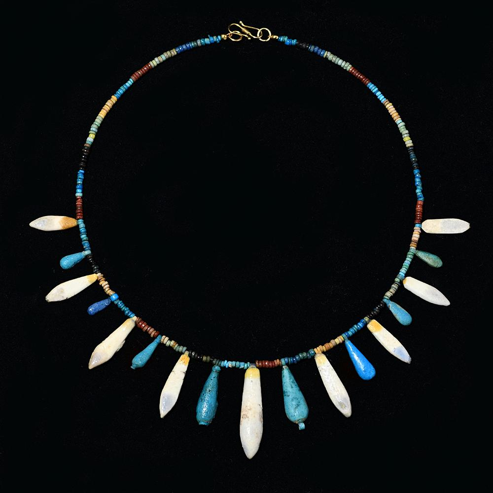 * An Amarna Faience Bead and Floral Pendant Necklace, 18th Dynasty, ca. 1353-1336 BCE