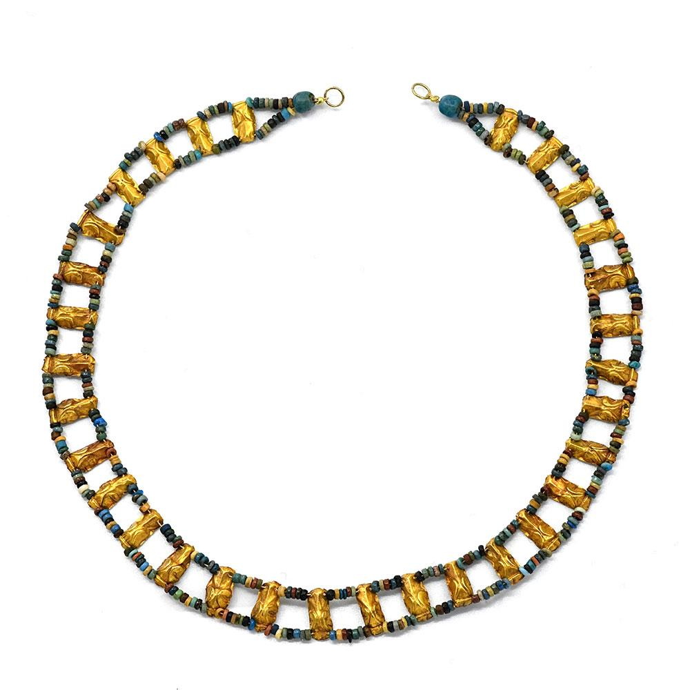 * An Egyptian Gold and faience Collar Necklace, Ptolemaic Period, ca 1st century BCE
