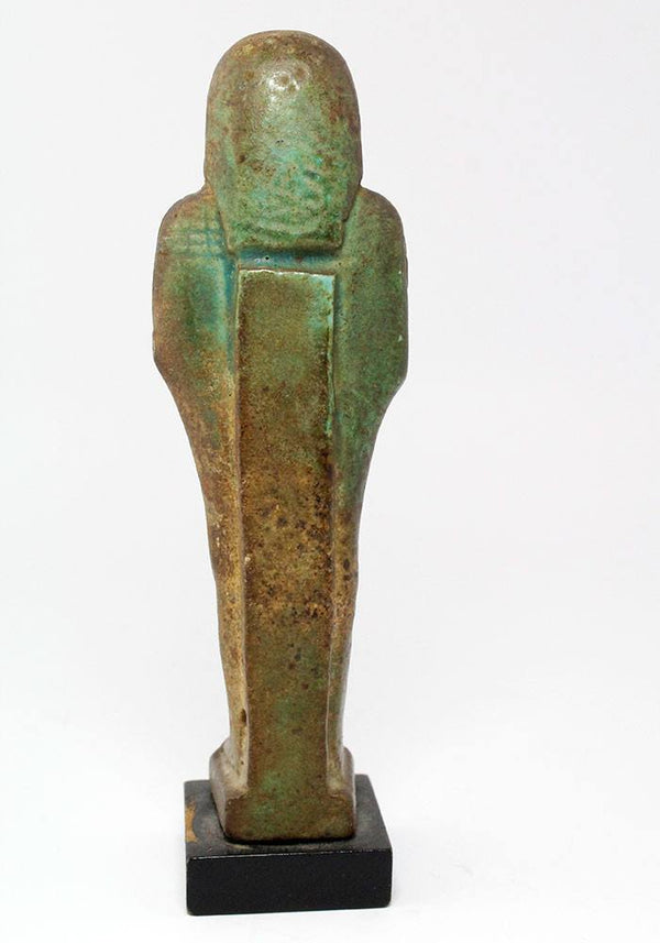 An Egyptian Green Glazed Faience Ushabti for Asetemkheb, 26th Dynasty c. 664 -525 B.C.