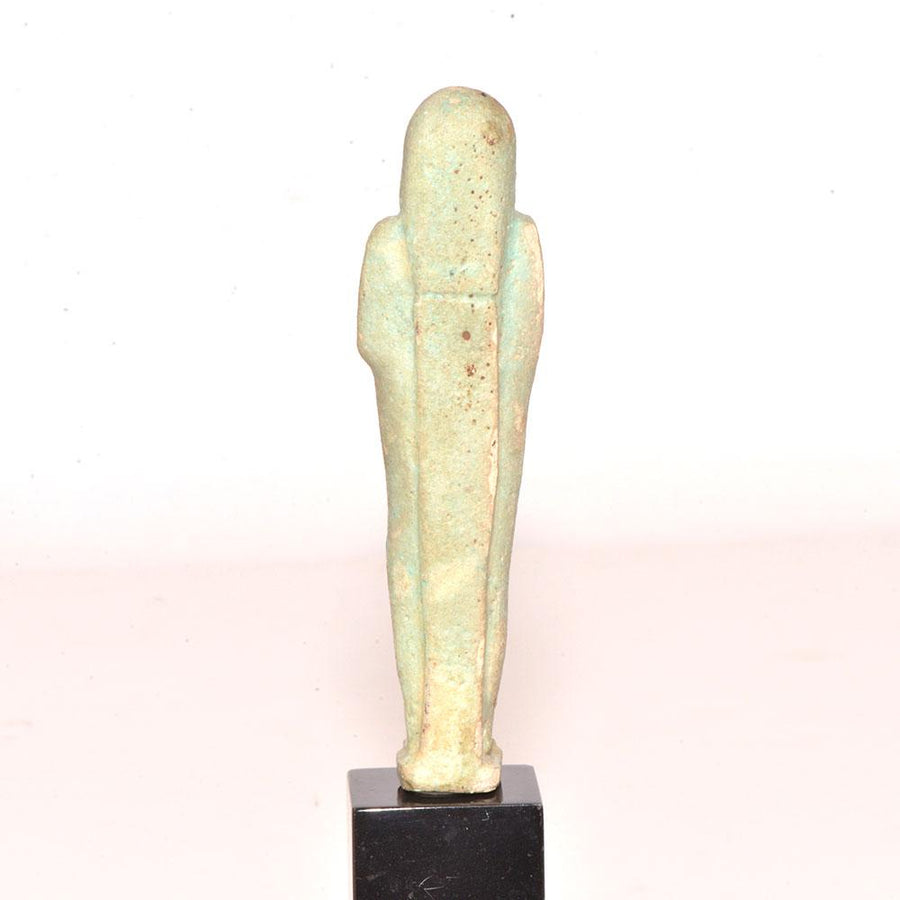 * An Egyptian Green Glazed Faience Shabti, Late Period, ca. 664-332 BC