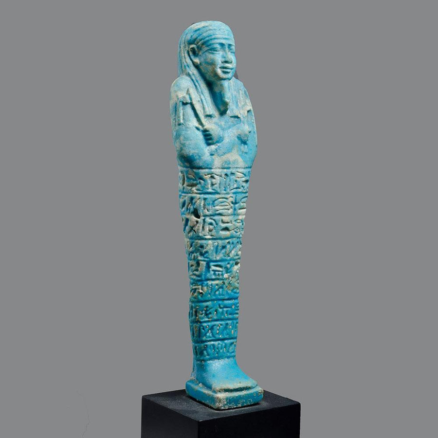 * A large Egyptian Faience Ushabti for AnkhEmAmon, Late Period, ca. 380- 343 BC