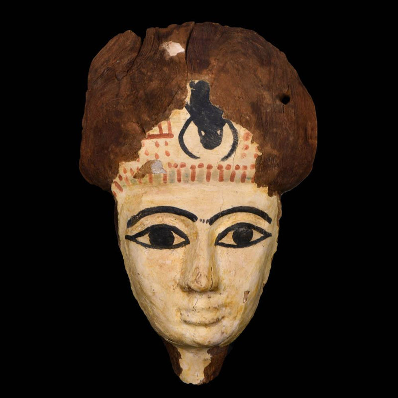 An Egyptian Wooden Mummy Mask, 21st Dynasty, ca. 1069 - 945 BCE