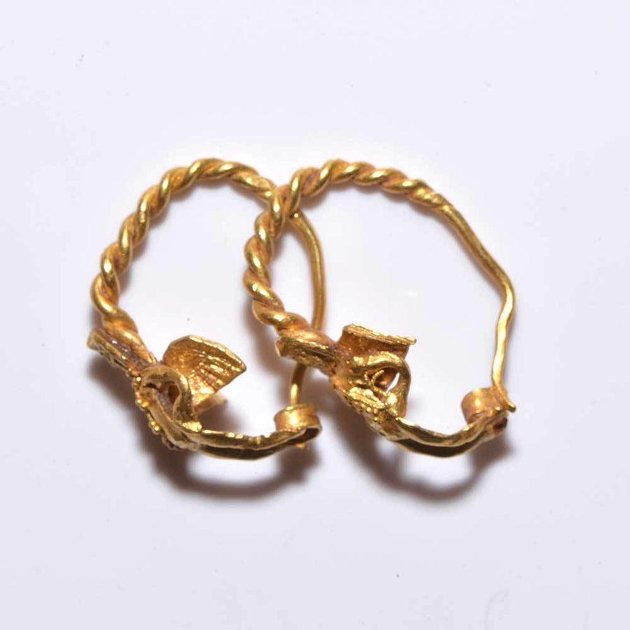 * A fine pair of gold figural Eros earrings, Hellenistic Period, 4th-3rd Century BC