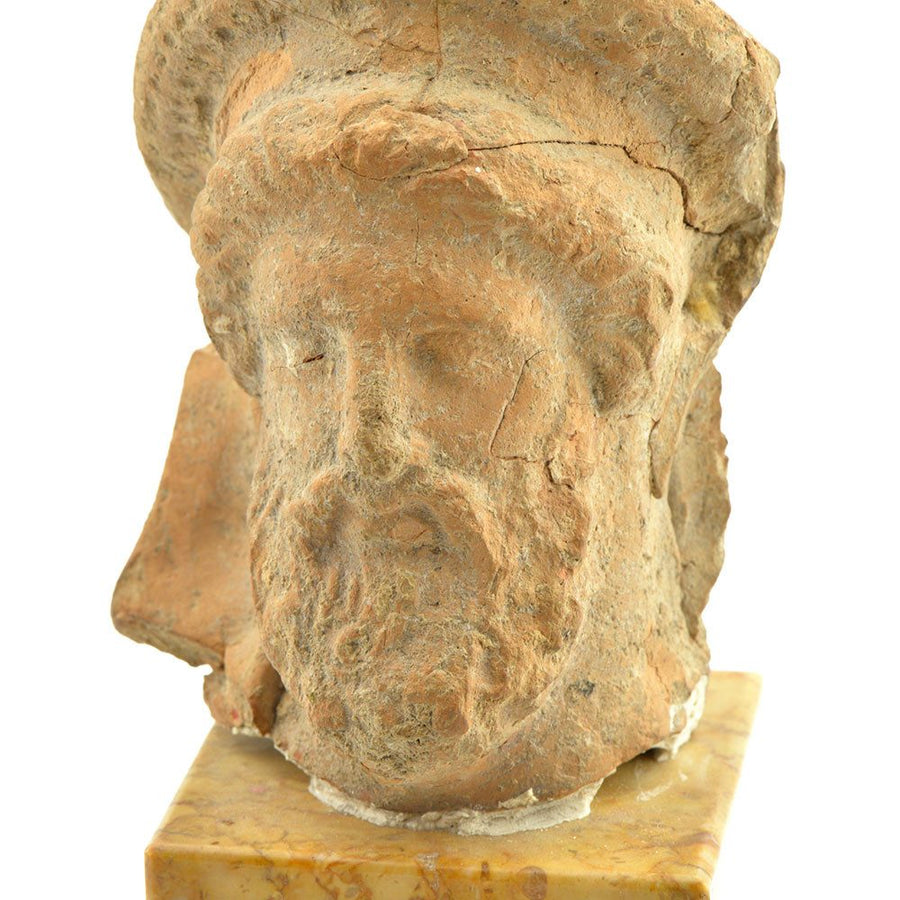 A Greek Terracotta Head of Dionysus, Hellenistic Period, ca.3rd - 1st century B.C. - Sands of Time Ancient Art