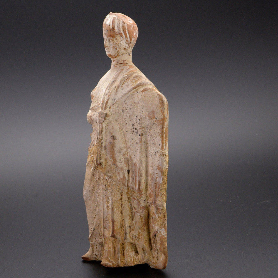 A Boeotian Tanagra Terracotta Figure of a Lady, Hellenistic Period, ca. 4th Century B.C.
