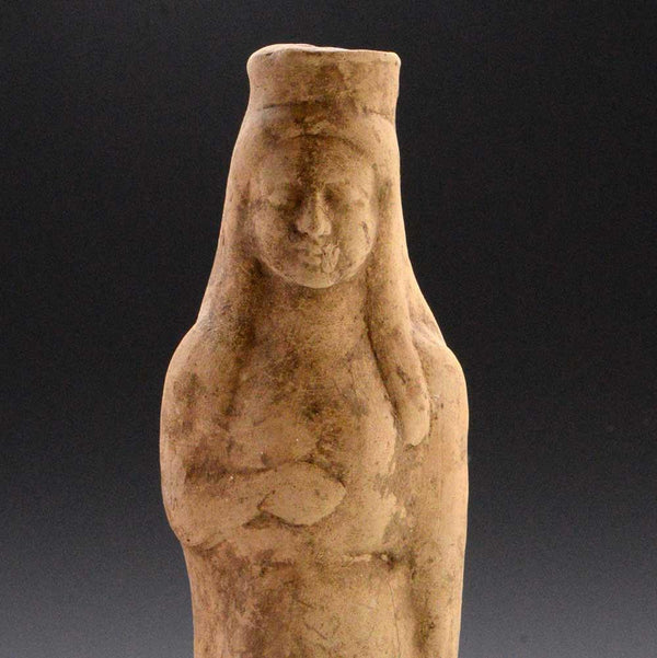 A large Greek Terracotta Statue of Kore, Archaic Period, ca 5th century BC