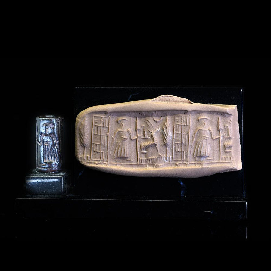 A Mesopotamian Serpentine Cylinder Seal of a Warrior, Age of Hammurabi, ca. 2000 BCE