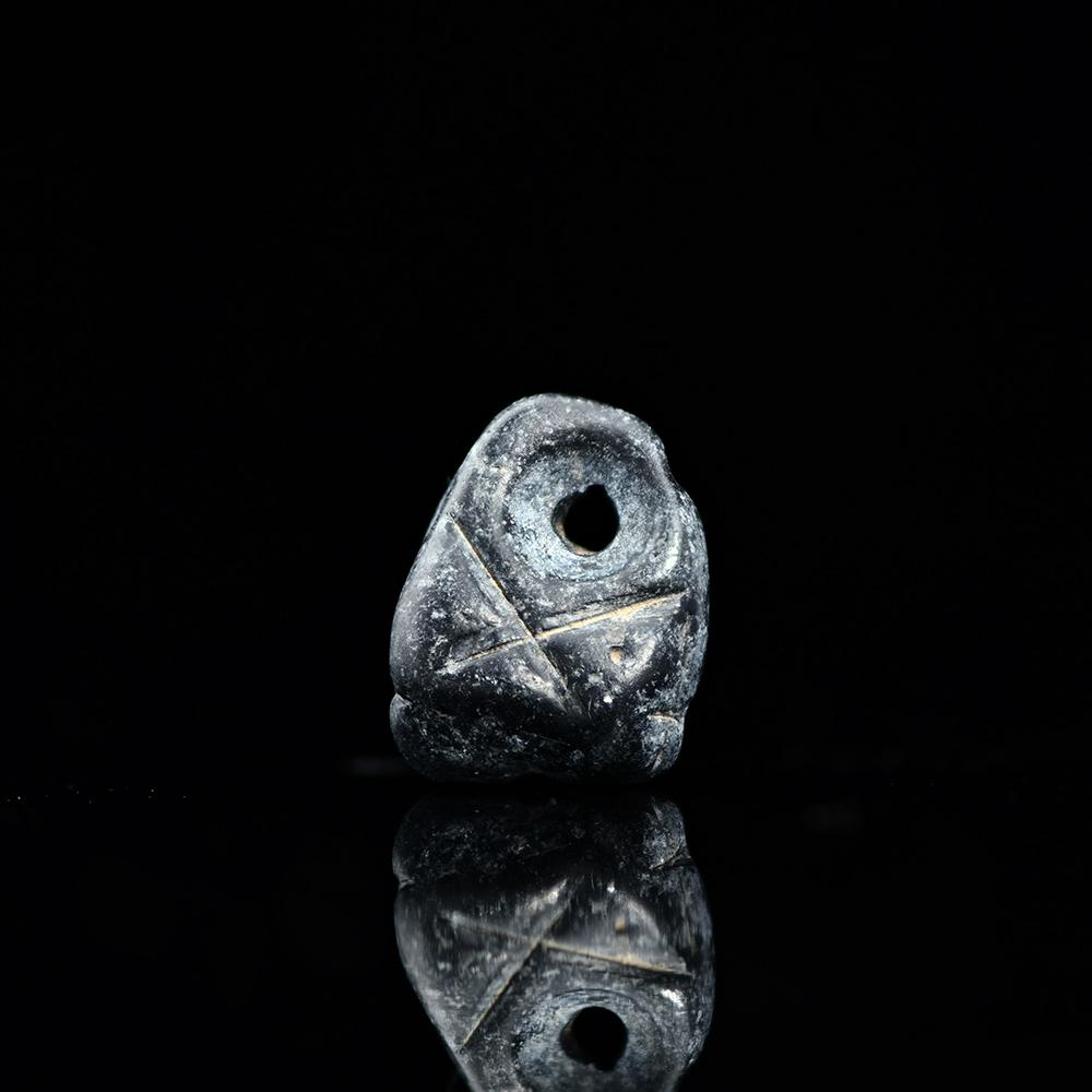 * A Mesopotamian Triangular Pendant Seal, Late Chalcolithic Period, ca. 4500-3200 BCE