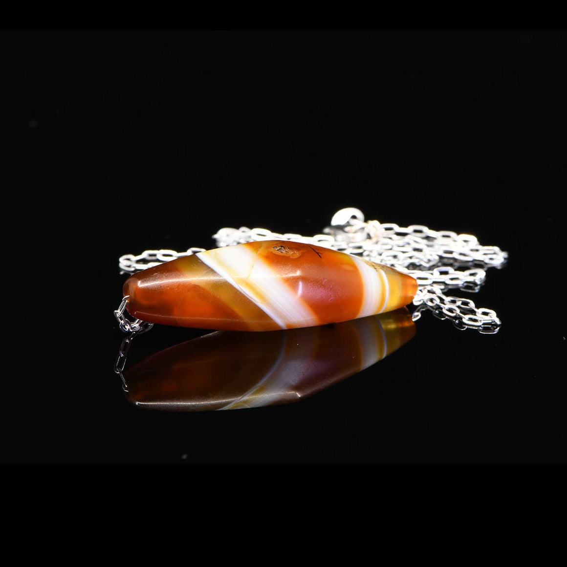 * A Western Asiatic Banded Agate Bead Pendant, ca 1st millennium BCE - Sands of Time Ancient Art