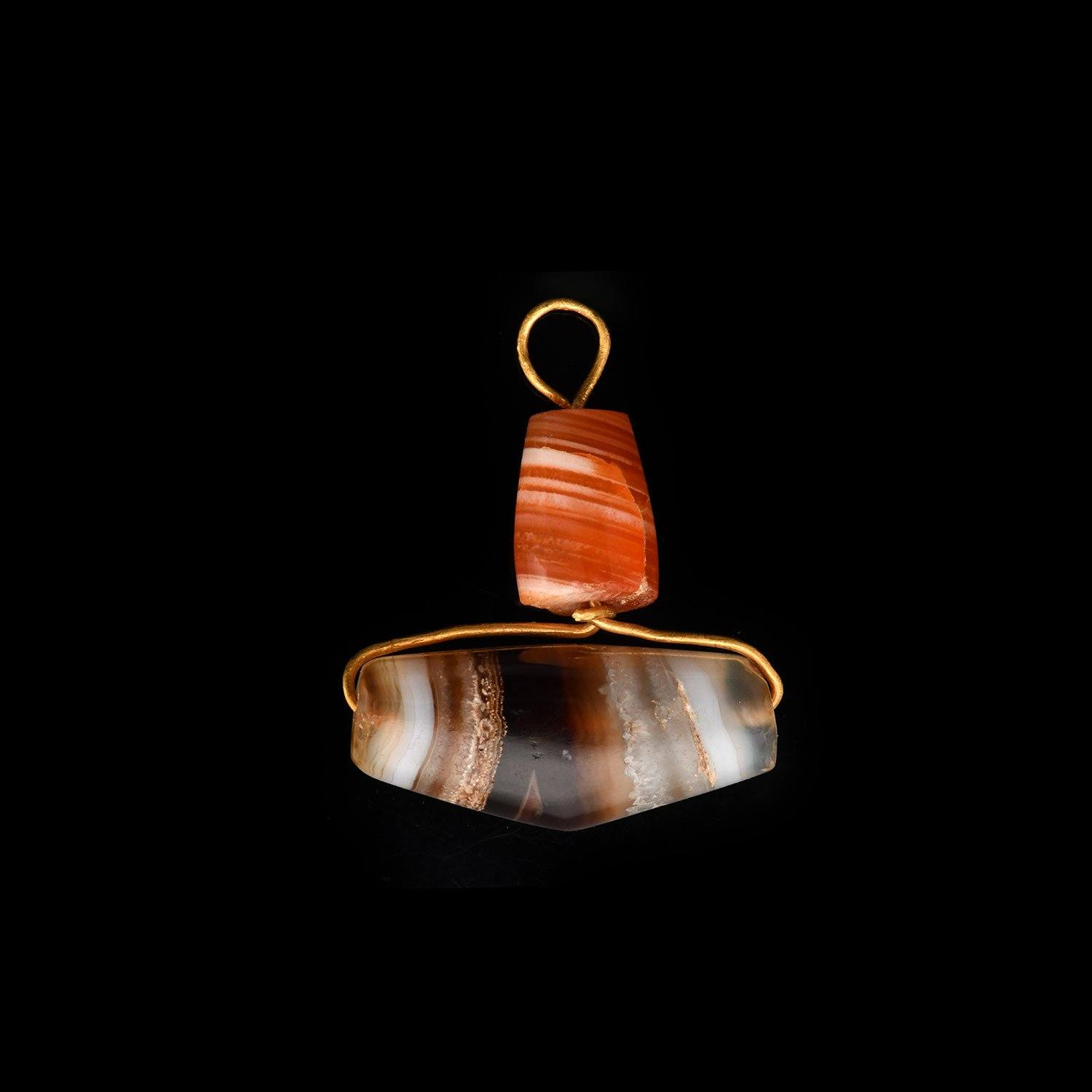 * A Persian Agate and Gold Pendant, ca. 550 - 330 BCE