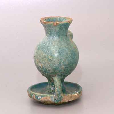 * A Persian Turquoise Glazed Oil Lamp, Seljuk period, 12th -13th century