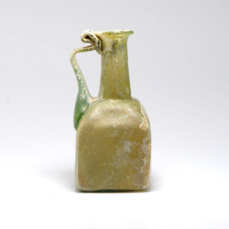 A Roman Green Glass Square Sided Juglet, Roman Imperial, 1st century AD - Sands of Time Ancient Art