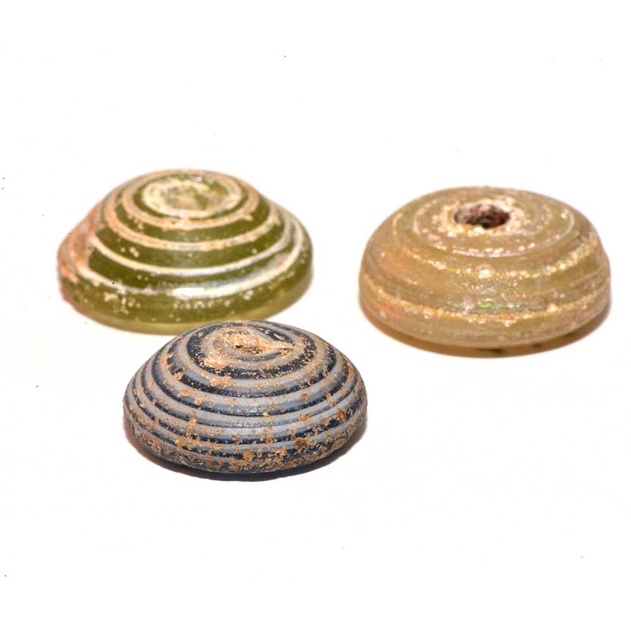 A set of three Roman Glass Spindle Whorls, Roman Imperial Period, ca. 3rd Century CE - Sands of Time Ancient Art