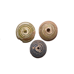 * A set of three Roman Glass Spindle Whorls, Roman Imperial Period, ca. 3rd Century AD - Sands of Time Ancient Art