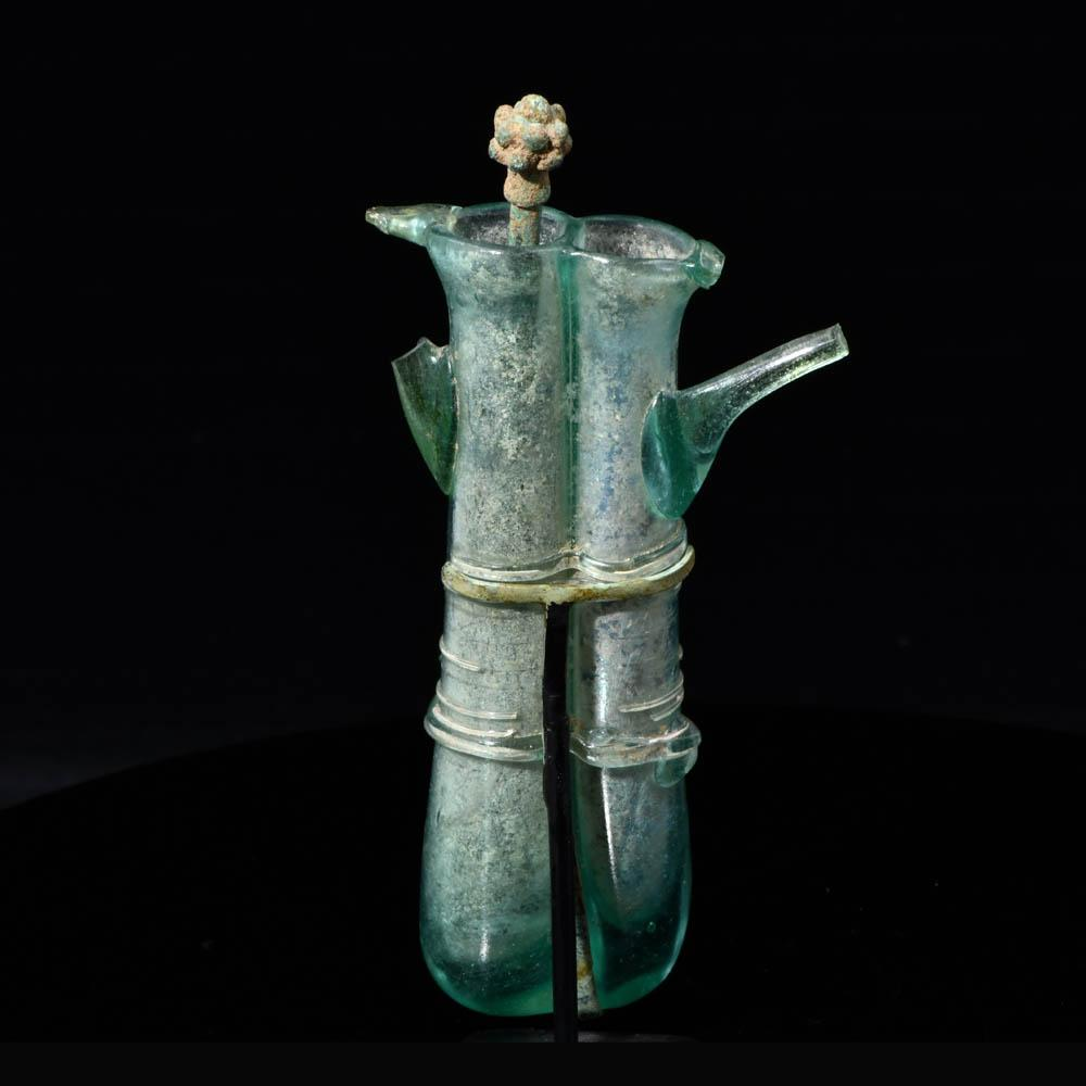 A Roman Glass Double Balsamarium with Applied Handles, ca. 4th century CE
