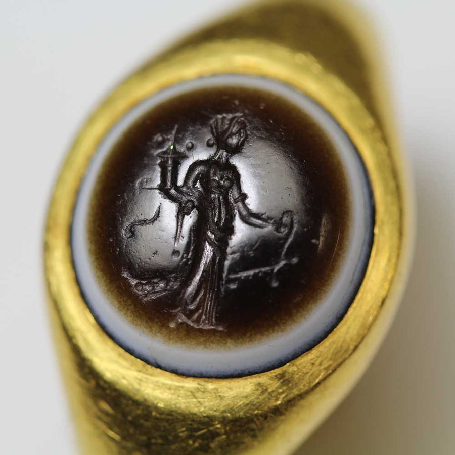 A Roman Eye-Agate Finger Ring with Fortuna Intaglio, ca. 1st Century BC/AD