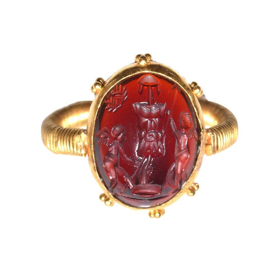 A Gold and Garnet Intaglio Ring, Etruscan Revival, ca. 19th Century