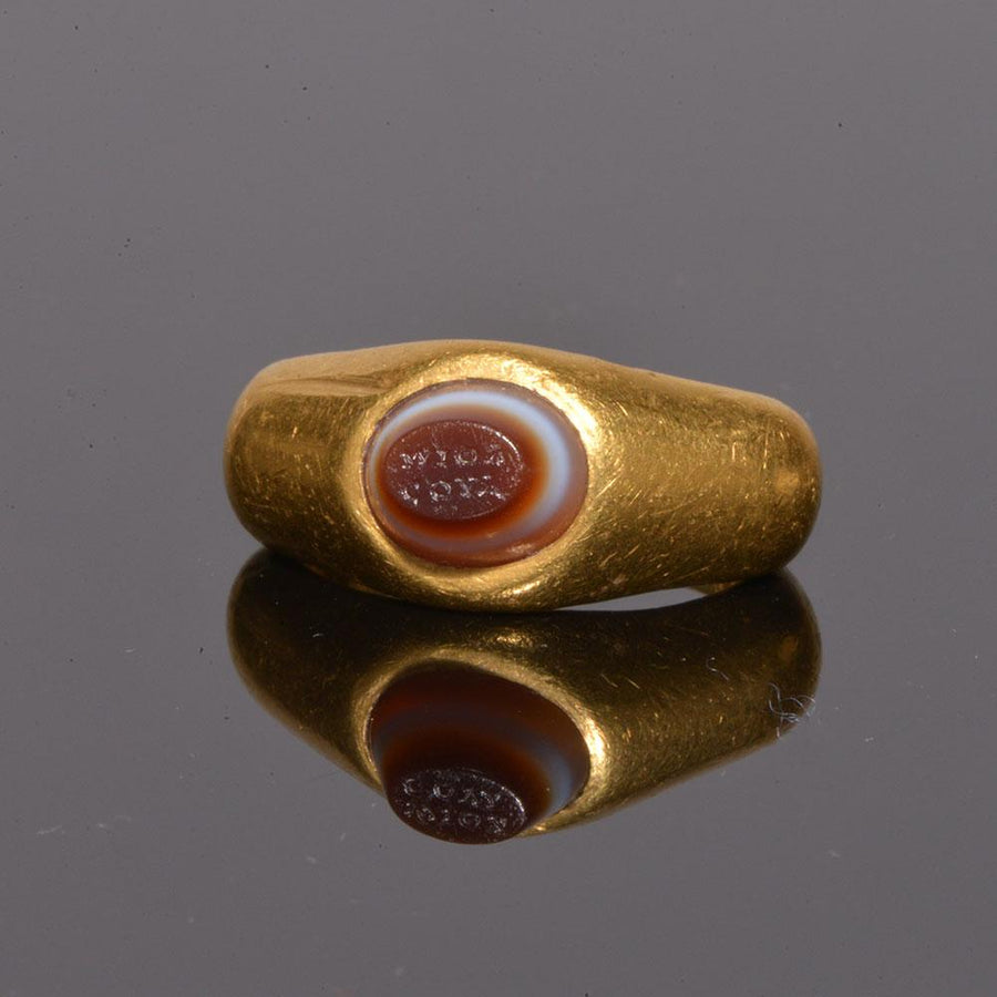 * An exhibited Roman Gold and inscribed Eye Agate Finger Ring, ca. 2nd century AD