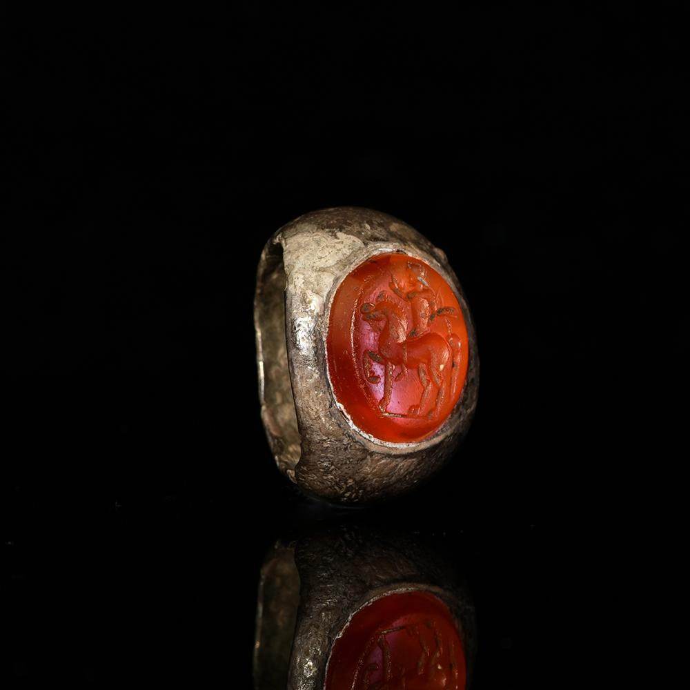 * A Roman Silver Ring with Carnelian Intaglio, Roman Imperial Period, ca. 2nd - 3rd century CE