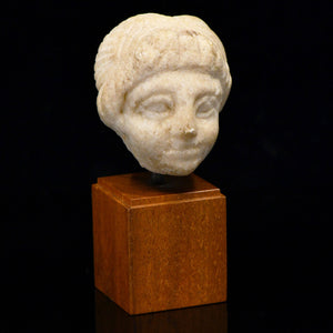A small Roman Head of a Child, Roman Imperial Period, ca. 1st century CE - Sands of Time Ancient Art