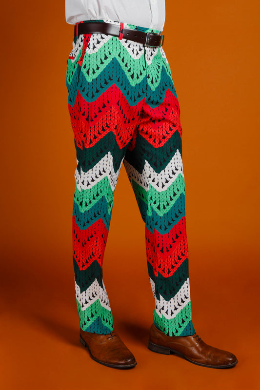 Red and green print holiday suit pants