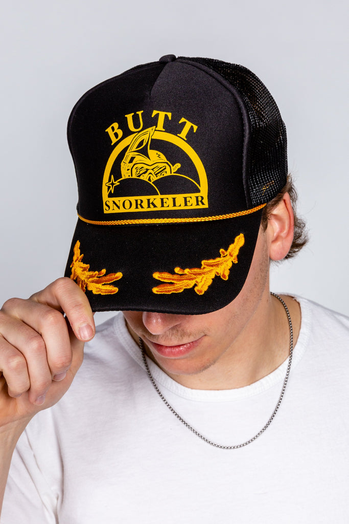 Capt. Phillips | Butt Snorkeler Black And Gold Snapback Hat