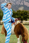 Man Wearing A Blue and White Checkered Suit Next To A Pony