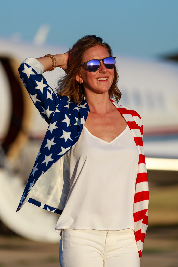 Woman Getting Off Airplane In The Women's USA Suit Jacket | The Martha J