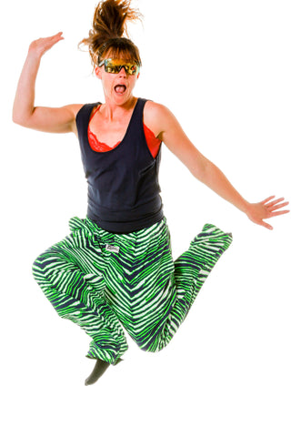 Woman wearing neon green zubaz NFL pants