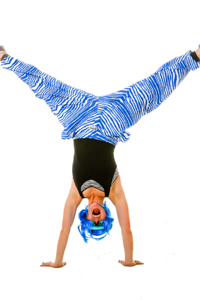 Woman Doing Handstand in Ladies Royal Blue and White Game Day Hammer Pants by Zubaz