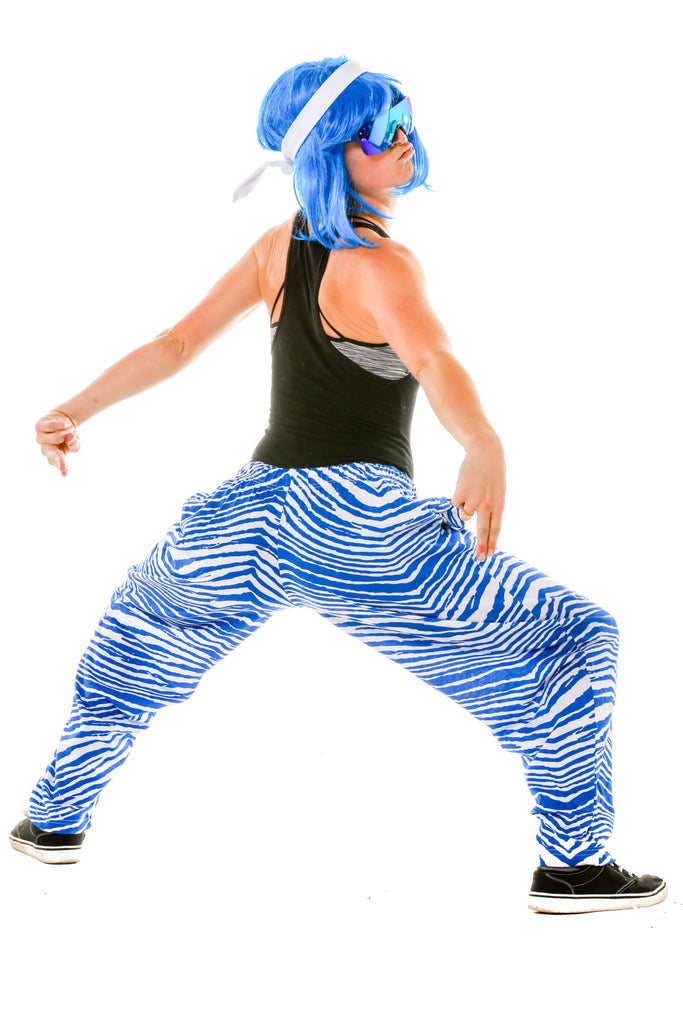 Lady wearing Ladies Royal Blue and White Game Day Hammer Pants by Zubaz