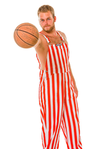 Guy in Red and White Overalls Holding a Basketball