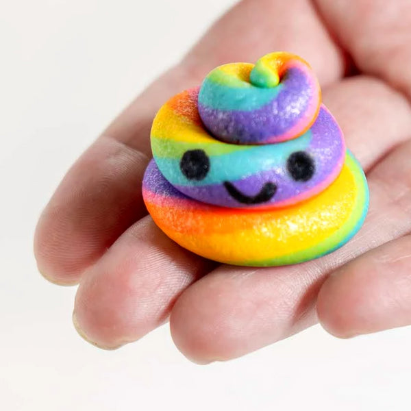 kawaii rainbow unicorn poop marzipan candy sculpture treats with happy faces close up
