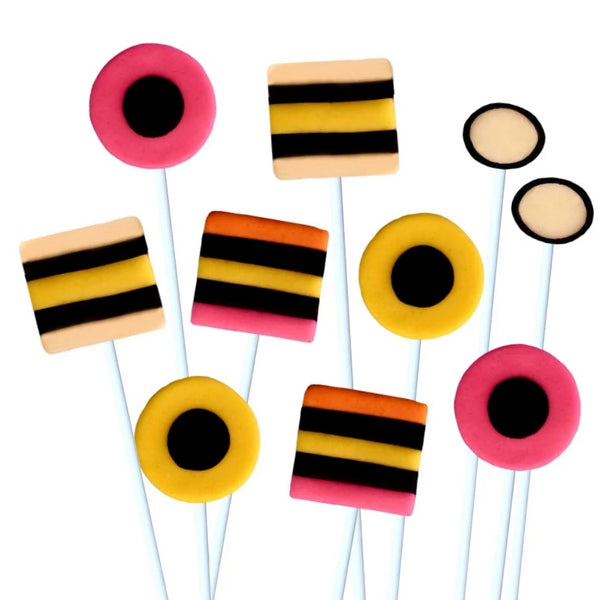 assorted allsorts in pink, yellow and black marzipan candy lollipops