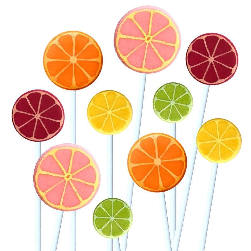citrus fruit with oranges, grapefruits, lemons and limes marzipan candy lollipops