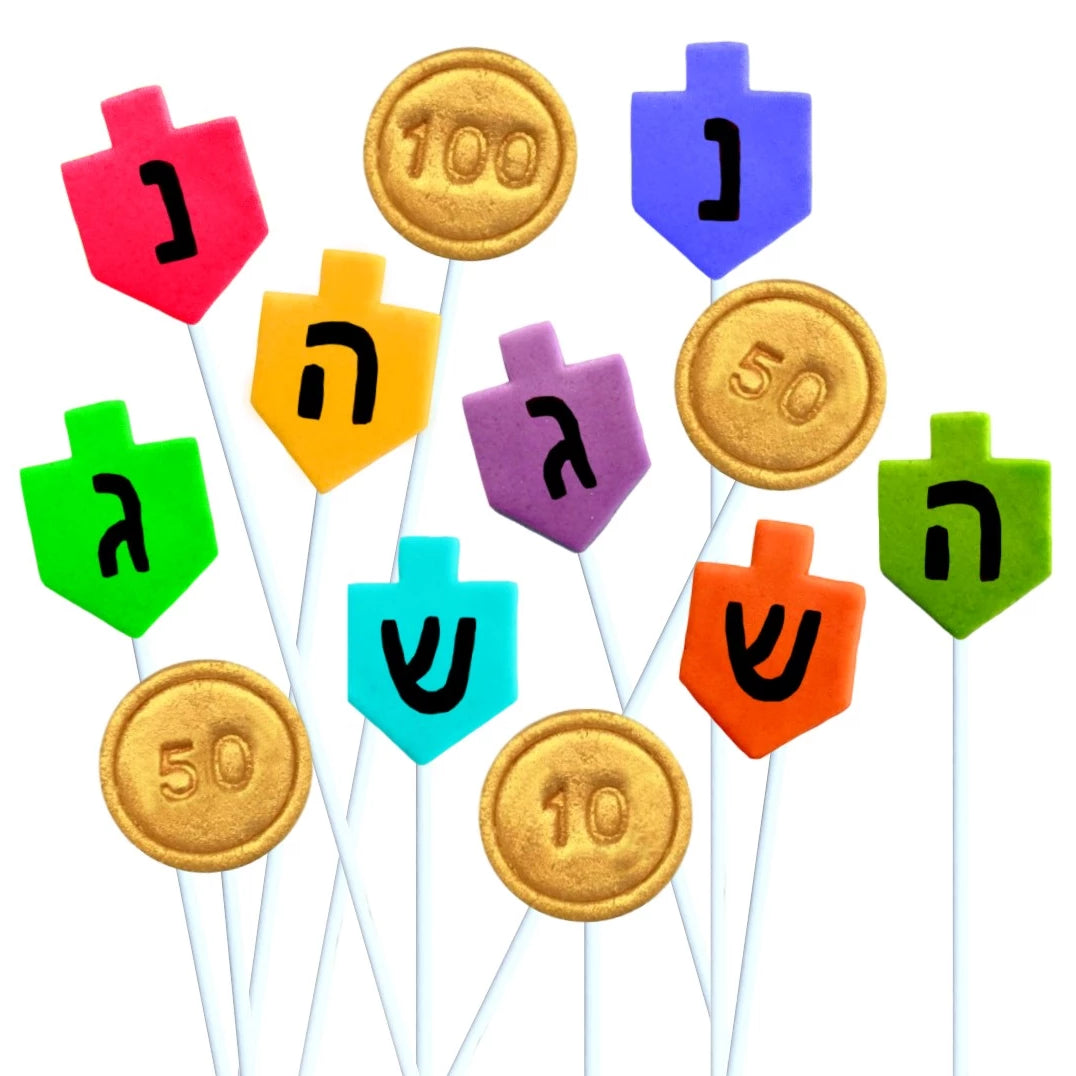 Hanukkah dreidels and gold gelt coins marzipan candy lollipops