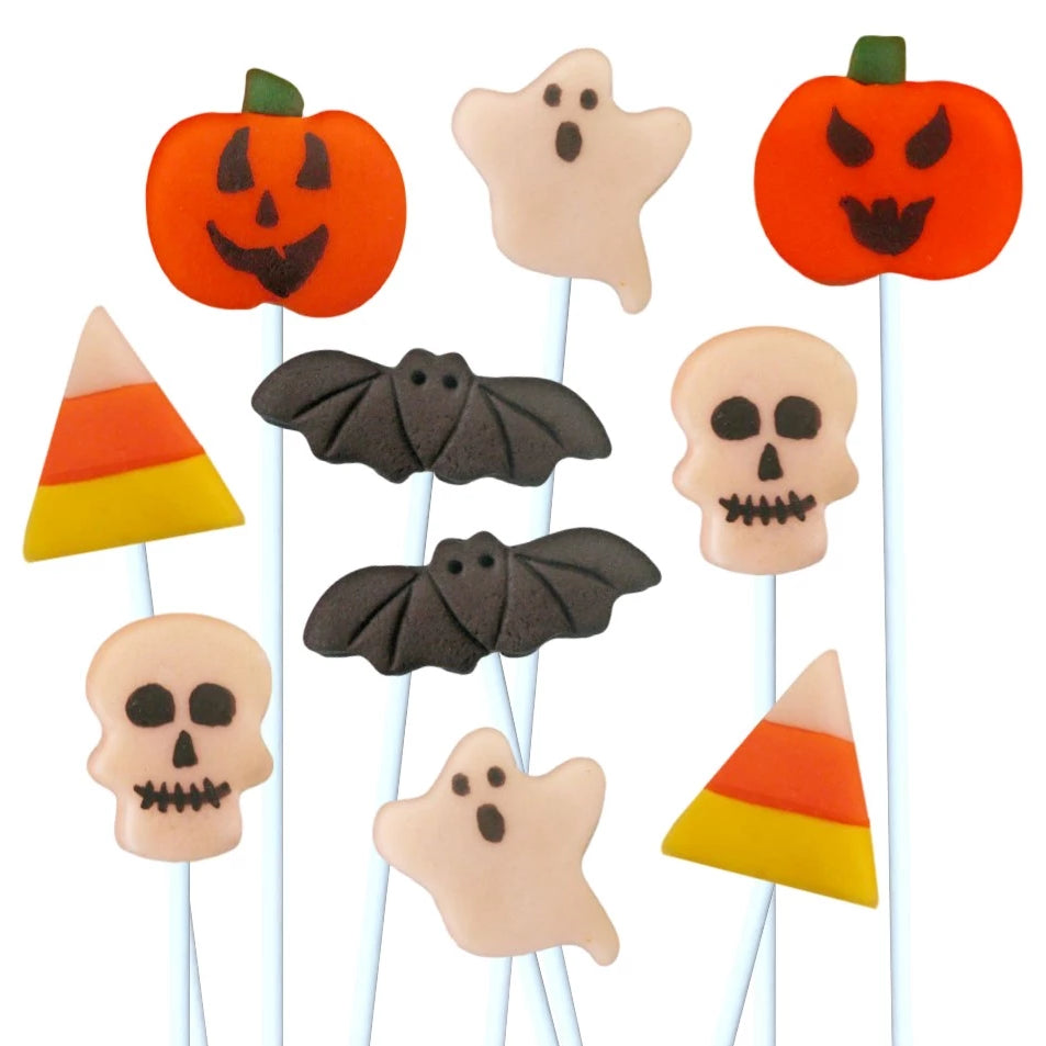 Halloween with ghosts, skulls, bats, jack o lantern pumpkins and candy corn marzipan candy lollipops
