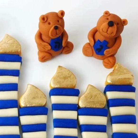 Hanukkah candles and teddy bears marzipan candy treats closeup