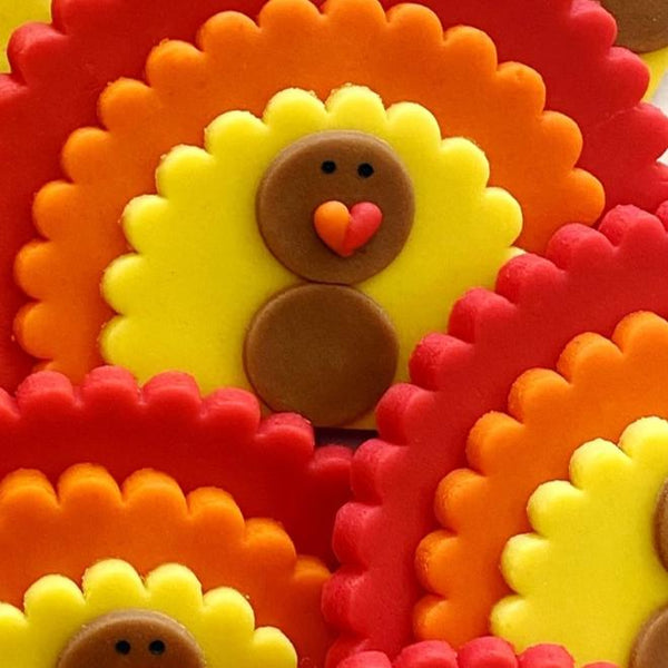 giant Thanksgiving turkeys marzipan candy lollipops in a pile