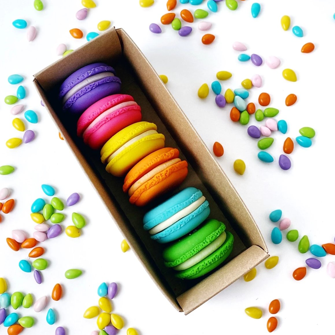 rainbow french macarons marzipan candy sculpture treats in a box